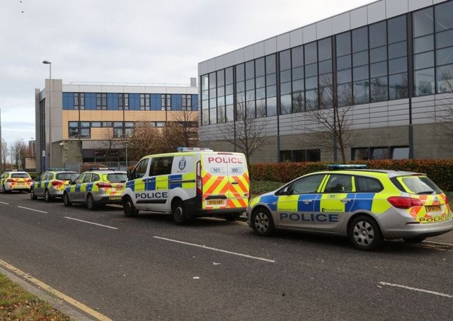 Police vehicles outside Edinburgh College's campus in Granton where a police officer suffered non life-threatening injuries after being stabbed in the back. Picture; PA