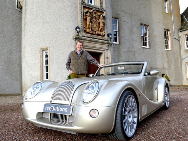North East 250 developer Guy Macpherson-Grant launches the route with a Morgan Aero 8 at Ballindalloch Castle. Picture: North East 250