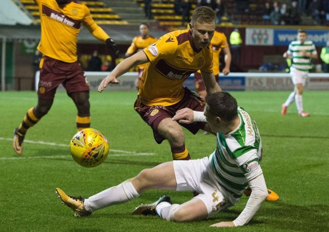Celtic's Callum McGregor wins a penalty as he goes down under the challenge of Andy Rose. Picture: Ross Parker/SNS