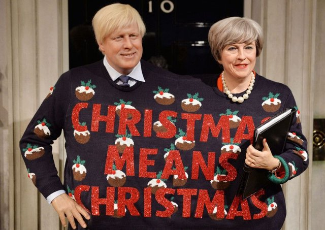 Madame Tussauds imagines Boris Johnson and Theresa May in a Christmas jumper made for two. Picture: PA