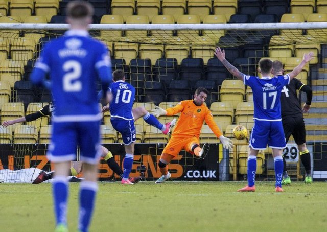 Chris Kane scores the winner for Queen of the South. Picture: Bruce White/SNS