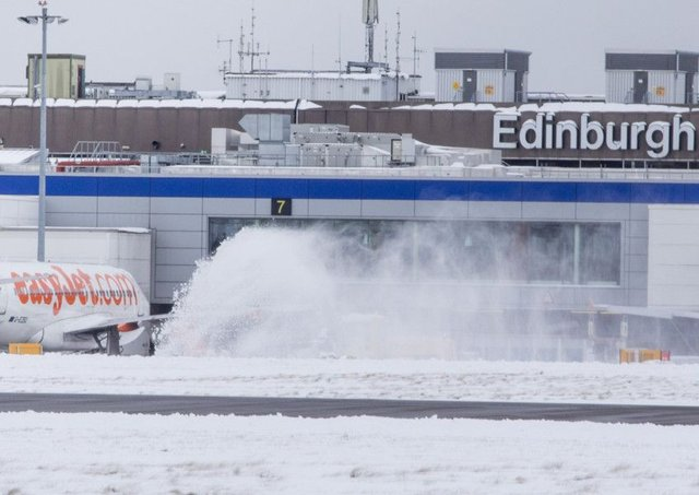 Edinburgh Airport was disrupted by 'the Beast from the East' a few weeks ago (pictured) Photo: SWNS