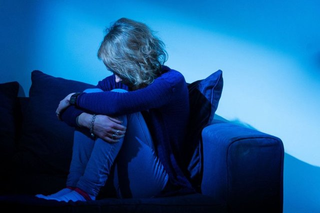 A woman showing signs of depression. Picture: Dominic Lipinski/PA Wire
