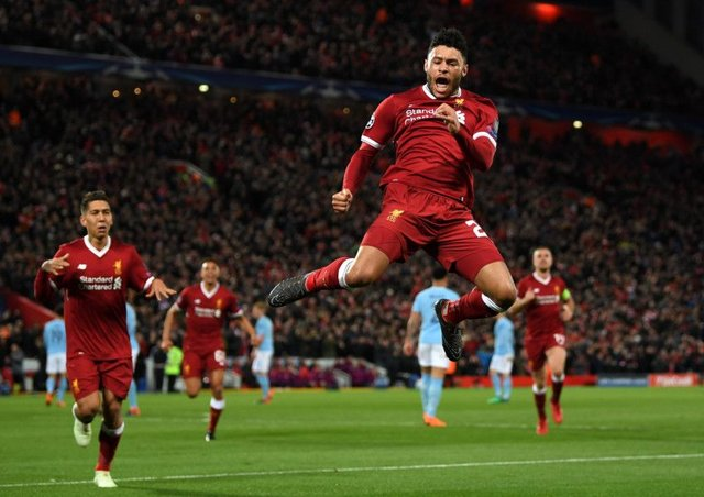 Alex Oxlade-Chamberlain celebrates after scoring Liverpool's second goal against Manchester City at Anfield. Picture: Shaun Botterill/Getty Images