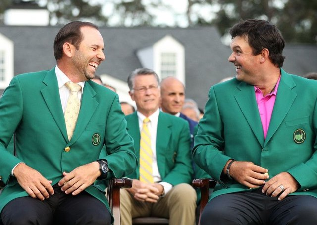 Patrick Reed, right, laughs with Sergio Garcia after being presented with the green jacket in honour of winning the 2018 Masters at Augusta.  Picture: Patrick Smith/Getty Images