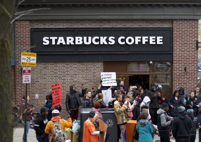 PHILADELPHIA, PA - APRIL 15:  Protestors demonstrate outside a Center City Starbucks in Philadelphia after police arrested two black men who were waiting inside the coffee shop. Picture: Mark Makela/Getty
