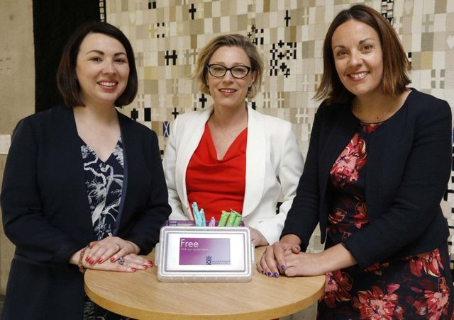 (L-R) Monica Lenon MSP, Gillian Martin MSP and Kezia Dugdale MSP at the launch the free sanitary products for women initiative at the Scottish Parliament in Edinburgh. Picture: Picture: Andrew Cowan/Scottish Parliament/PA Wire