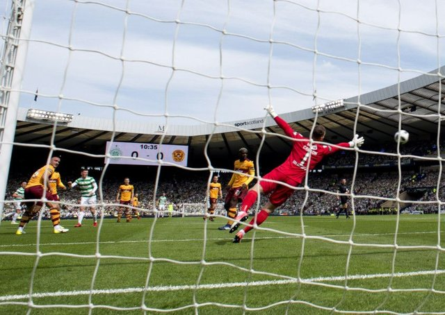 Callum McGregor, with his weaker right foot, fires the ball beyond Trevor Carson for Celtics opening goal. Picture: SNS.