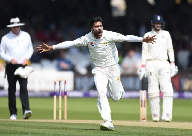 Mohammad Amir celebrates dismissing Jonathan Bairstow during day three of the first Test. Photograph: Gareth Copley/Getty