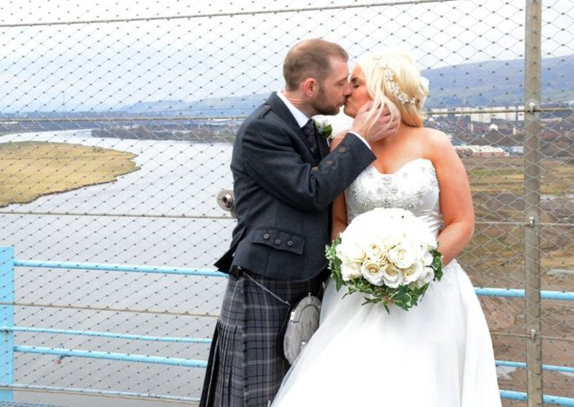 Kate and Barry Elliot tied to knot at the top of the Titan crane on the banks of the River Clyde. Picture: SWNS