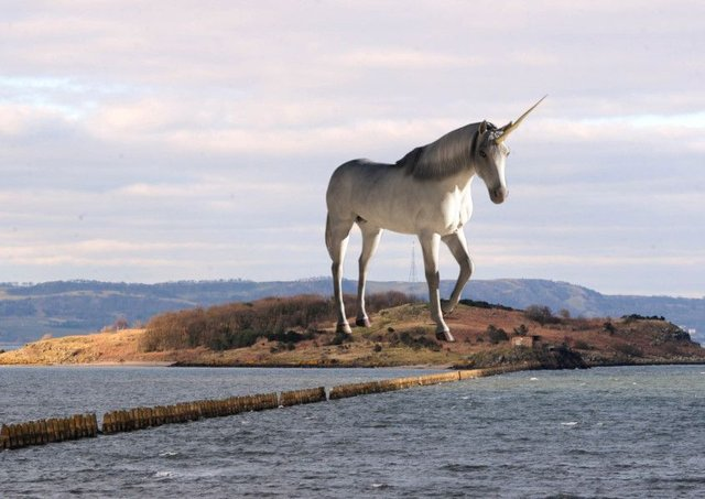 A composite image showing what a large statue of a unicorn on Cramond Island in the Firth of Forth might look like