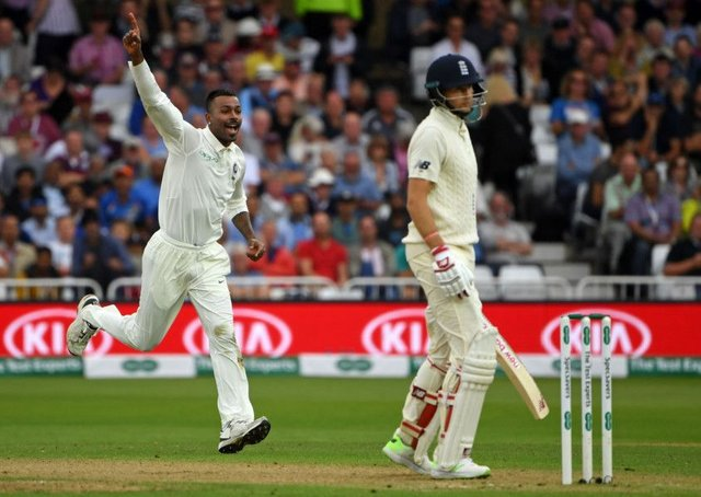 Indias Hardik Pandya celebrates after claiming the wicket of England captain Joe Root on a dramatic second day 