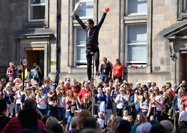 An Edinburgh Festival Fringe entertainer performs on the Royal Mile Picture: Jeff J Mitchell/Getty Images