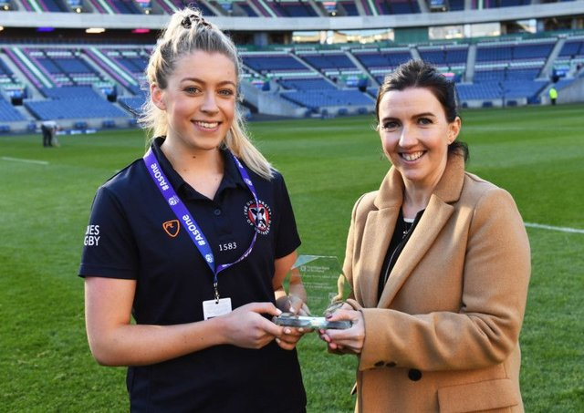 Player of the match Lucy Winter is presented with her award by Fiona Chadwick. Picture: SNS Group