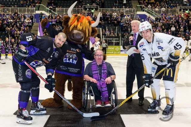 "Jamie Wilson, centre, has been described as the ""biggest fan"" of the Glasgow Clan ice hockey team. Picture: Contributed"