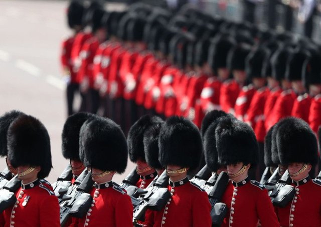 The Coldstream Guards march along Horseguards Parade ahead of the Trooping the Colour event for the Queens birthday (Picture: Daniel Leal-Olivas/AFP/Getty)