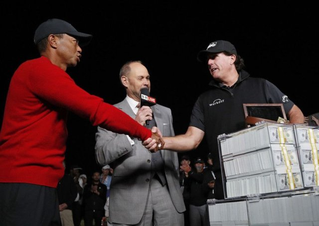 Tiger Woods, left, shakes hands after losing 'The Match' to Phil Mickelson, right, at Shadow Creek in Las Vegas. Picture: AP