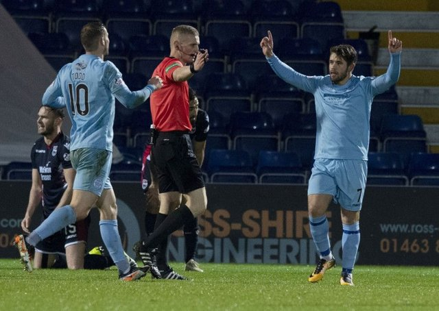 Queen of the South's Andrew Stirling celebrates his equaliser. Pic: SNS/Paul Devlin