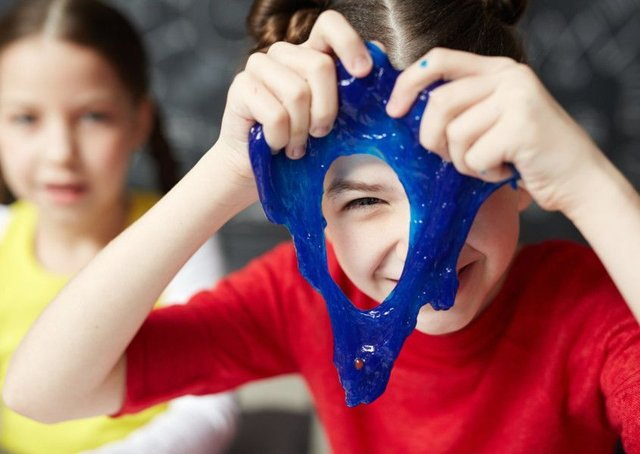 Children playing with the blue slime being sold by major UK toy retailers