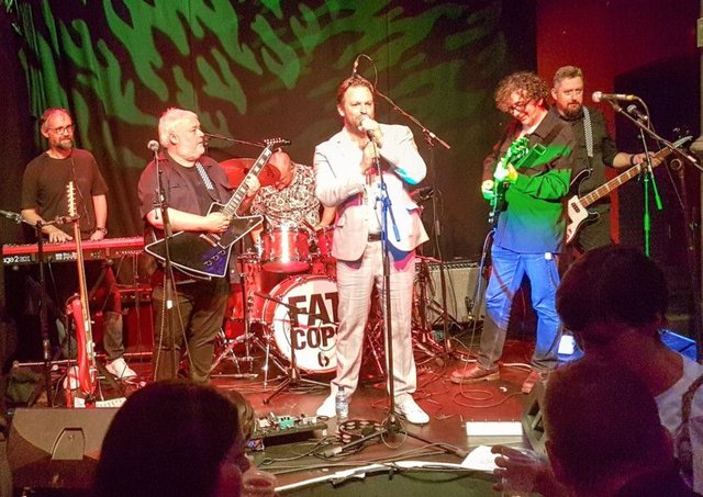 Neil, Euan, Al, Chris, Bobby and Chris performing as Fat Cops, whose album is out in March