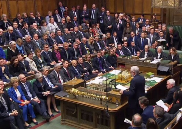 Jeremy Corbyn (R) standing to give his response and to table a motion of no confidence in the Government. Picture: Getty