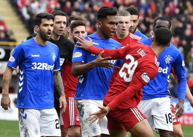 Rangers' Alfredo Morelos clashes with  Aberdeen's Max Lowe in the Scottish Cup quarter-final at Pittodrie. Picture: SNS