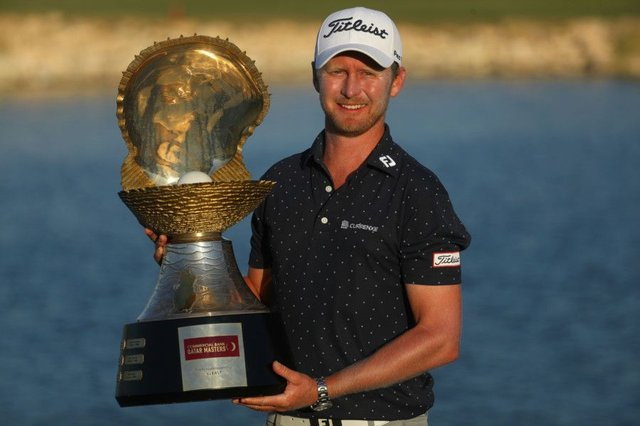 Justin Harding shows off the Mother of Pearl trophy in Doha. Picture: Getty