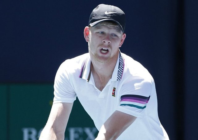 Kyle Edmund prepares to serve to John Isner at  the Miami Open. Picture: Joel Auerbach/AP