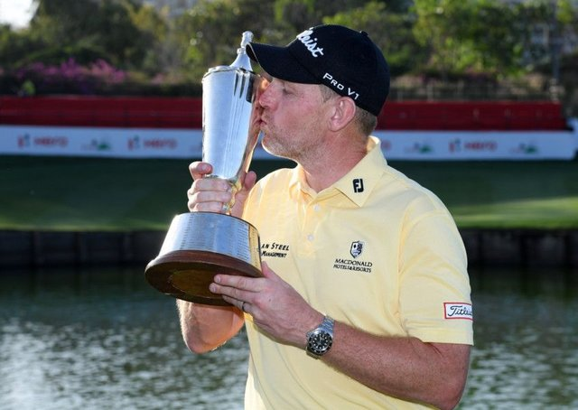 Stephen Gallacher kisses the trophy following his victory in the Hero Indian Open. Picture: Getty