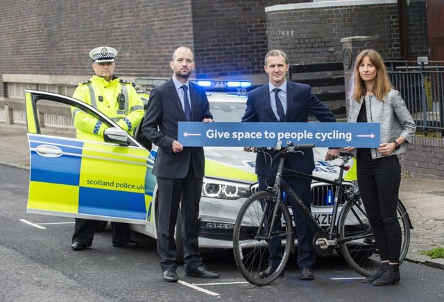 Inspector Andrew Thomson (Police Scotland), Cycling Scotland chief executive Keith Irving, Michael Matheson (Cabinet Secretary for Transport, Infrastructure and Connectivity) and Cycling Scotland head of communications Denise Hamilton at the launch of Cycling Scotland's annual cycling road safety campaign in Glasgow.