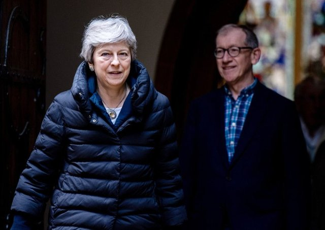 Theresa May and her husband Philip leave after attending a Sunday service at her local church on May 5. Picture: Getty