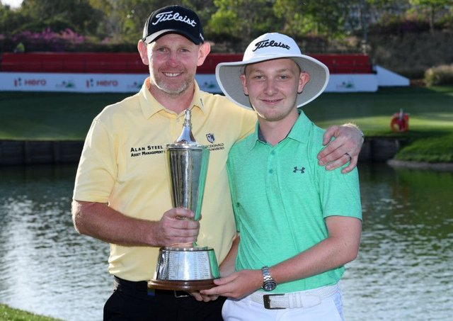 Stephen Gallacher, pictured with his son Jack after winning the Hero Indian Open, is playing in next week's GolfSixes. Picture: Getty Images