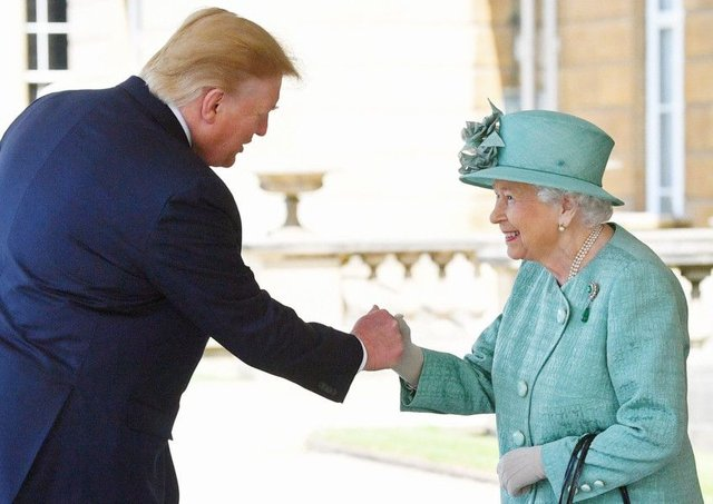 Queen Elizabeth II greets US President Donald Trump as he arrives for the Ceremonial Welcome at Buckingham Palace, London. Photo: Victoria Jones/PA Wire