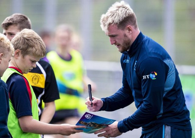 Scotland full-back Stuart Hogg signs an autograph for a fan in Inverness, where Gregor Townsends extended training squad gathered to kick off their preparations for the World Cup. Picture: SNS/SRU