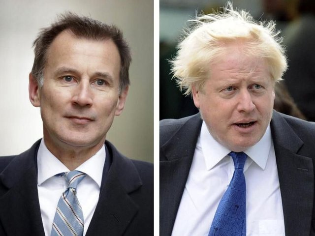 Jeremy Hunt (left) and Boris Johnson. Picture: AP