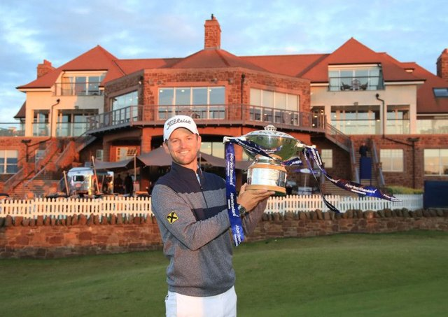 Austrian Bernd Wiesberger  with the Scottish Open trophy following victory  at The Renaissance Club.
