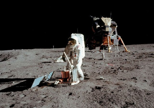 Apollo 11 space mission US astronaut Buzz Aldrin is seen conducting experiments on the moon's surface in a picture taken by Neil Armstrong (Picture: Neil Armstrong/Nasa via AFP/Getty)
