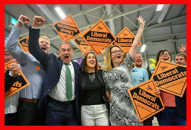Liberal Democrat MP Jane Dodds, centre, celebrates with supporters as she wins the seat in the Brecon and Radnorshire by-election at the Royal Welsh Showground, Llanelwedd, Builth Wells. PRESS ASSOCIATION