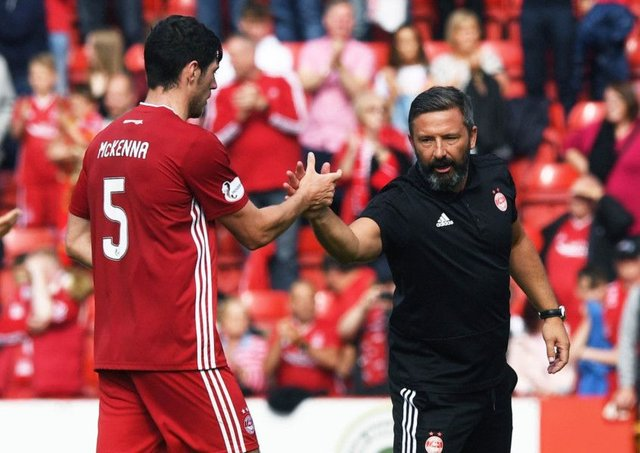 Aberdeens Scott McKenna and manager Derek McInnes celebrate at the end of their 3-2 win over Hearts at Pittodrie on Sunday. Picture: SNS.