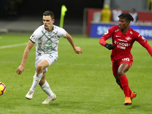 Filip Uremovic (left) vies for the ball with Spartak Moscow's Sylvanus Nimely