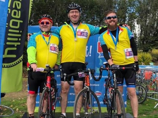 Glasgow father-of-two Colin Anderson (centre) was cycling with best friend Ian Laidlaw and son Fraser as part of a team when he collapsed during the charity Pedal for Scotland event on Sunday