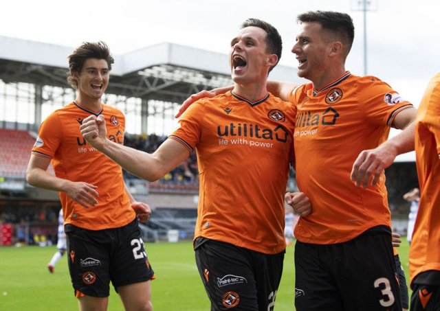 Dundee United's Lawrence Shankland (centre) celebrates his second goal with Adrian Sporle. Picture: SNS