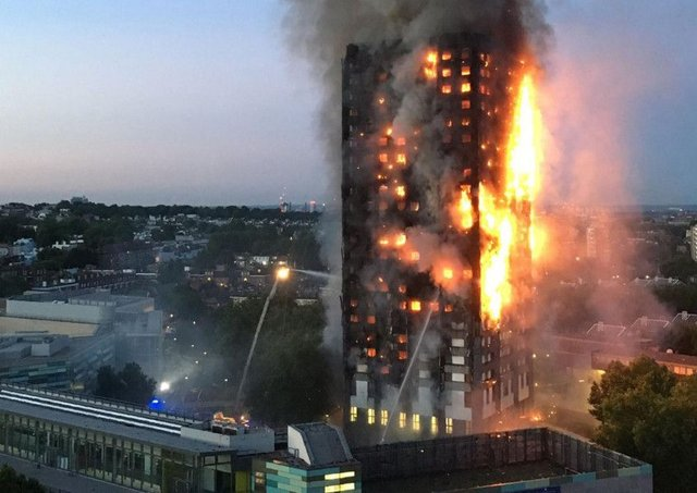 The 24-storey Grenfell Tower in west London was rapidly engulfed by the fire in June 2017 as it spread along the building's flammable cladding. (Picture: Getty Images)