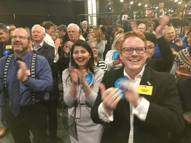 Conservative supporters cheer as candidate David Duguid holds onto Brexit-supporting Banff and Buchan.