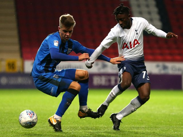 Jack Tucker (left) in action for Gillingham against Tottenham Hotspur in a Checkatrade Trophy clash