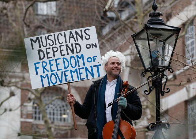 British-German musician Simon Wallfisch poses with his cello outside Europe House in London on January 10, 2019 before his monthly musical performance to protest against Britain's exit from the European Union.