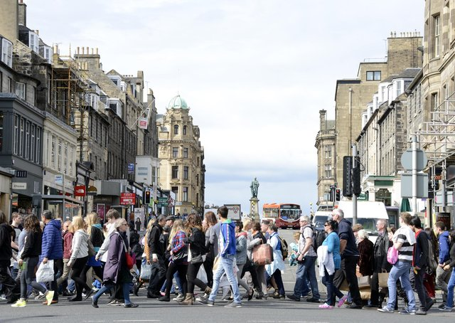 Shoppers on Princes Street in Edinburgh. Rishi Sunak has not ruled out every person in the UK being issued with a 500 pound voucher to spend on the high street. Picture: Andy O'Brien