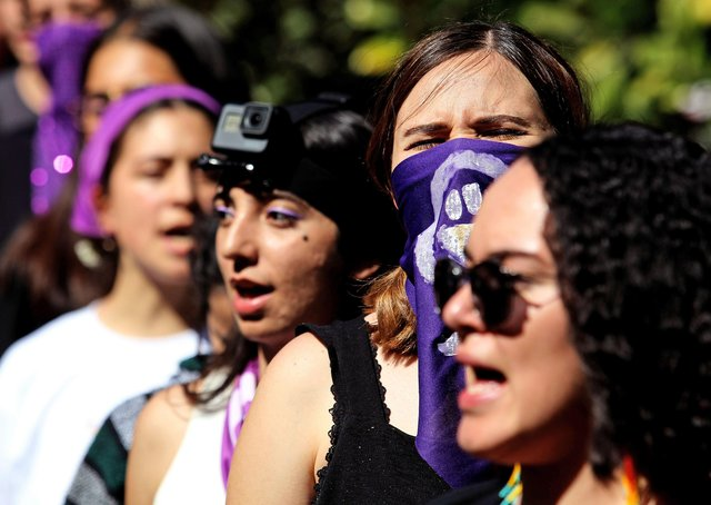 Students sing 'El violador eres tú' (The rapist, is you) – a song by the Chilean feminist collective Las Tesis – during a demonstration against gender violence and patriarchy in Guadalajara, Mexico, ahead of International Women's Day (Picture: Ulises Ruiz/ via Getty Images)