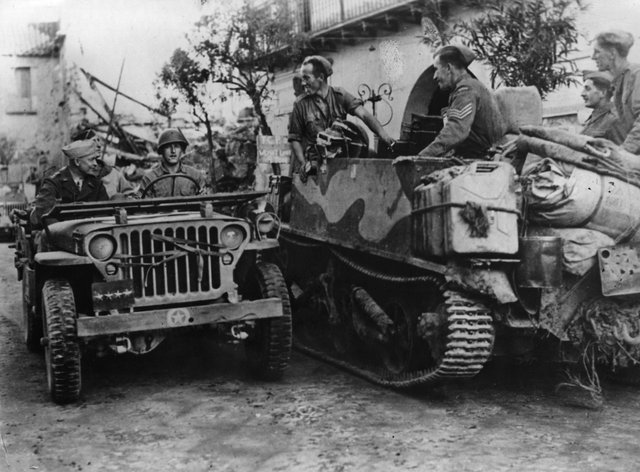 Dwight Eisenhower is driven in a jeep to visit the Italian war front. Picture: Getty