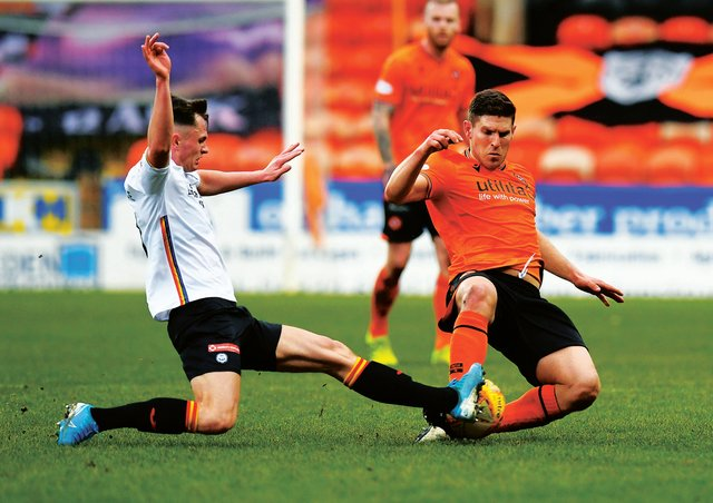 Dundee United's Dillon Powers, right, was on target against Partick Thistle. Picture: Ross MacDonald / SNS